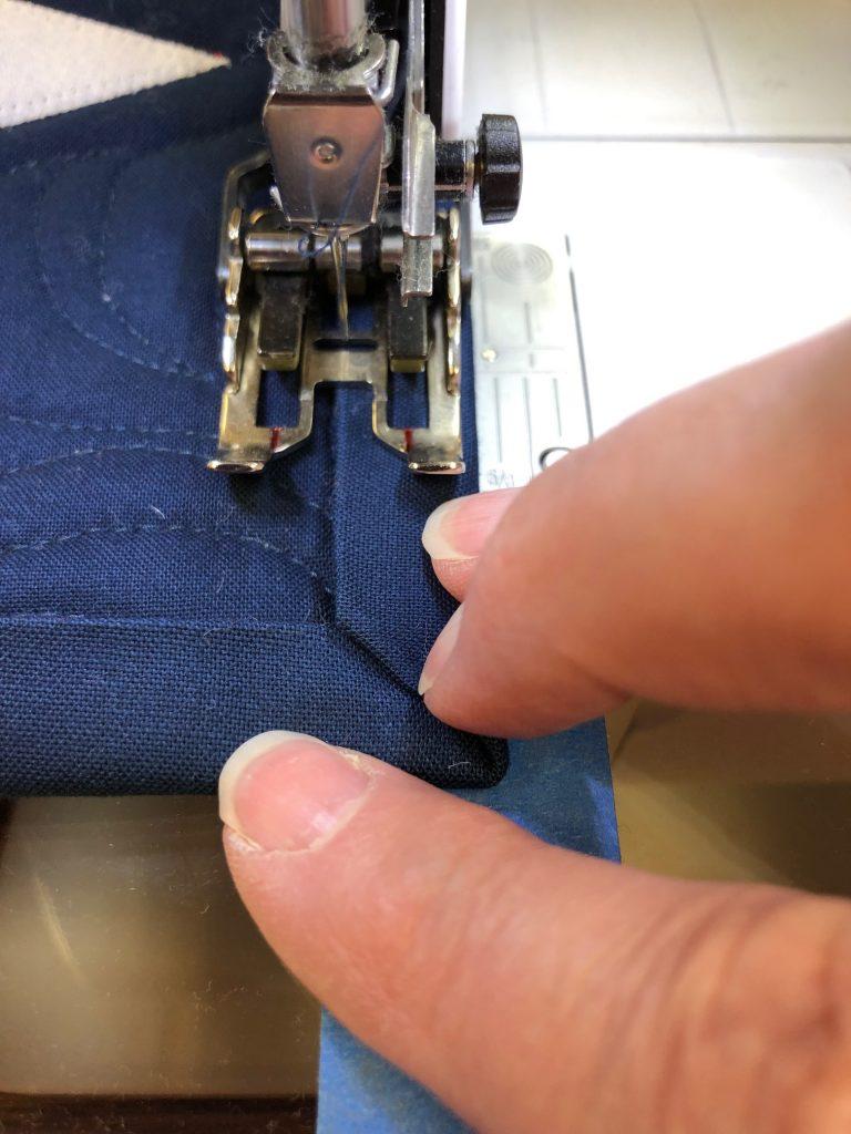 Machine binding a quilt | APQS