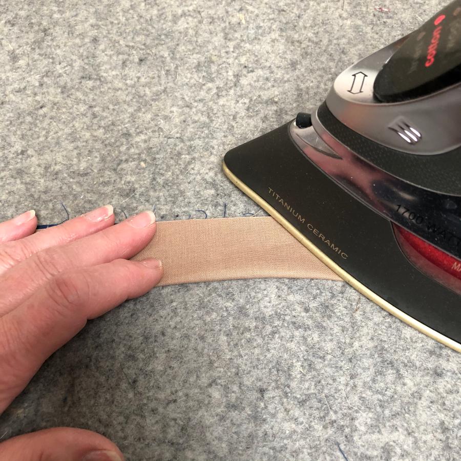 Using an iron to press your binding strips.