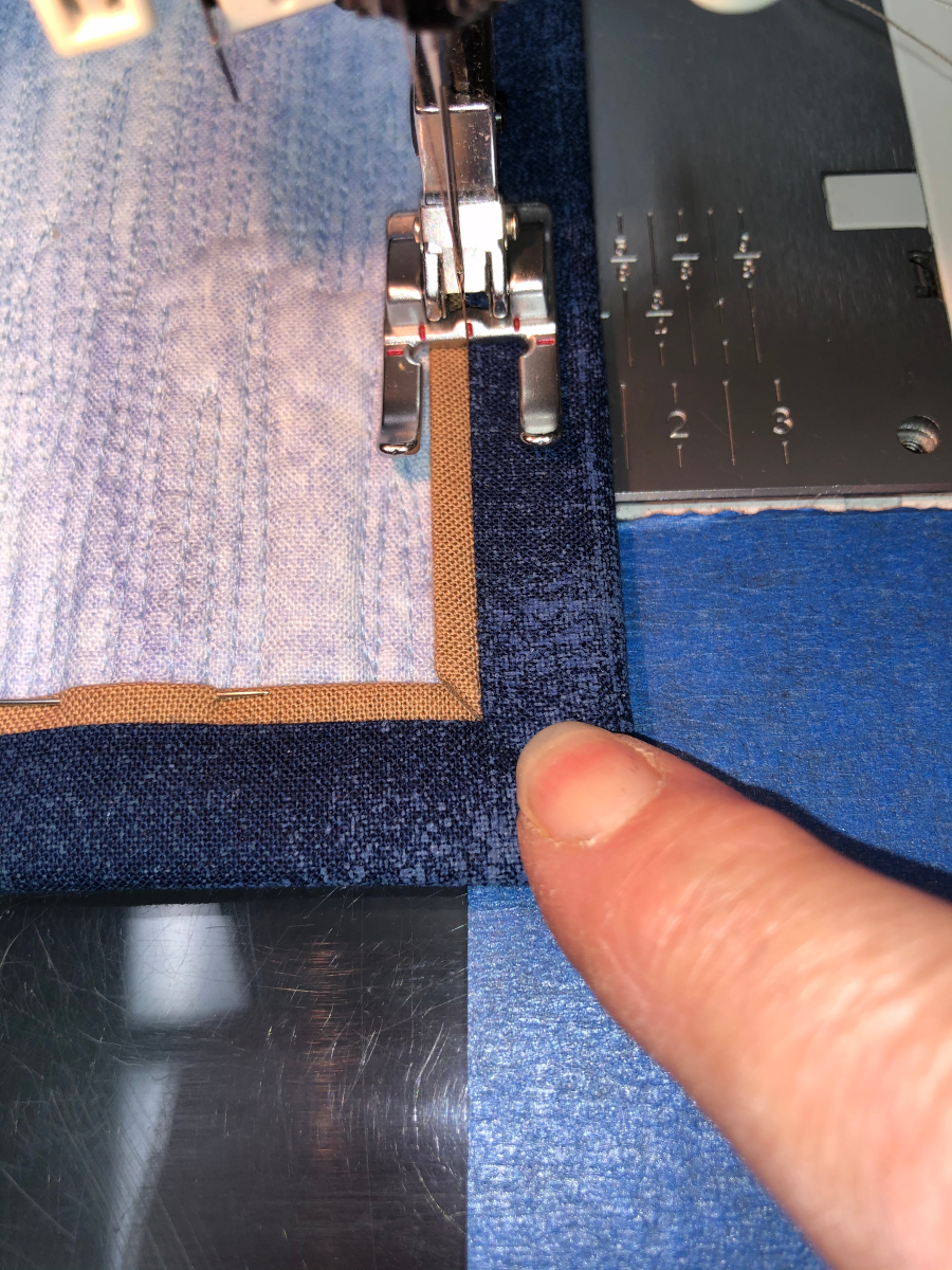Stitching next to the seam for faux piping.