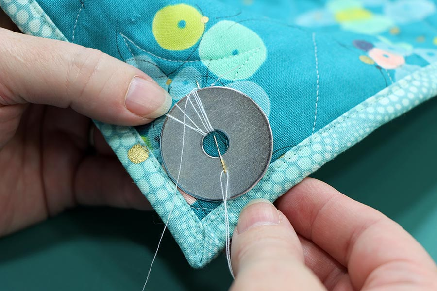 Sewing weight to a quilt to help it hang flat
